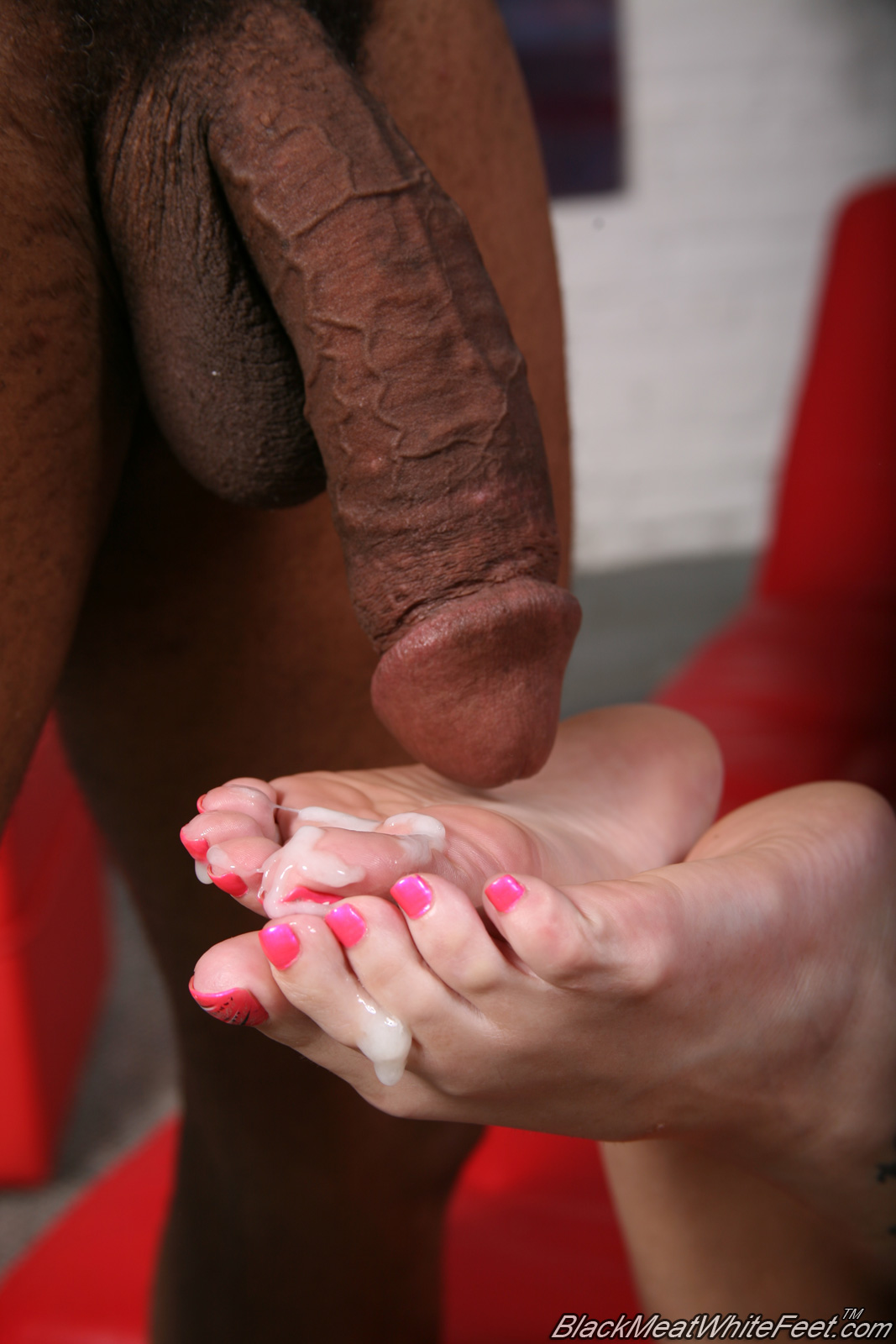 Mature footjob black cock